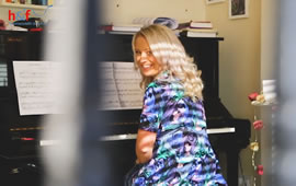Pianist Performs to West Kensington From Her Flat